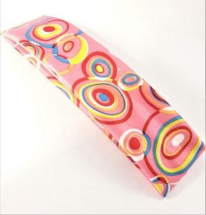 Hårband i glada färger och mönster, elastiskt, rosa bottenfärg