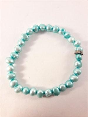 Enkelt Armband med Små Turkosfärgade Pärlor och Ring med Strass
