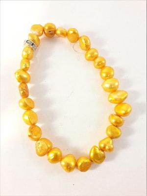 Enkelt Armband med Orange Pärlor och Ring med Strass