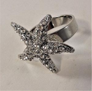 Snygg ring med gnistrande vit sjöstjärna, 18 mm