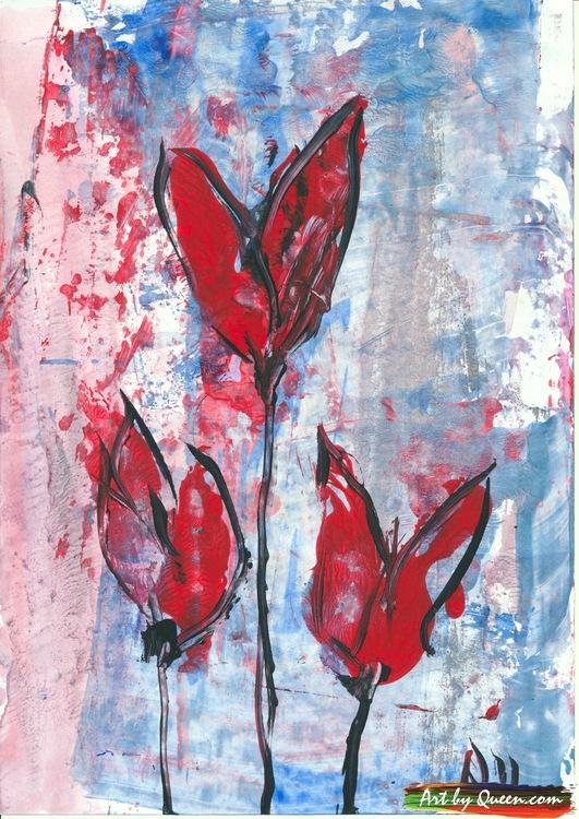 Tre vackra tulpaner blommar