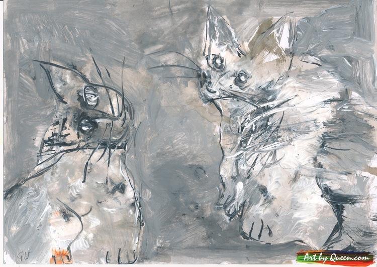 Två katter leker