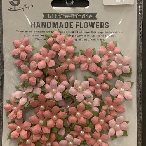 Rosa blommor med pärla