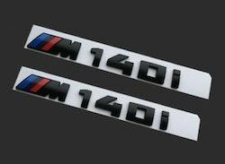 BMW Modellbeteckning M140i Svart