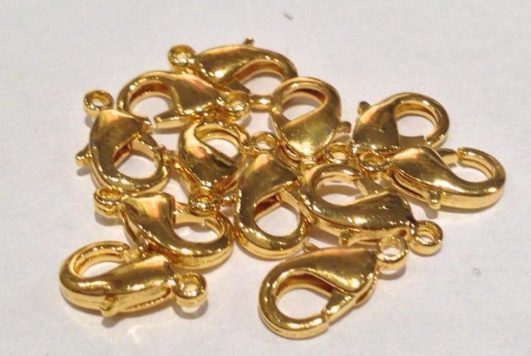 Guldfärgade klolås 10 mm, ca 10 st
