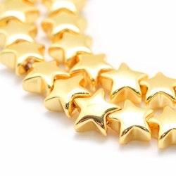 Guldfärgad hematit, stjärnor 8 mm, 10 st