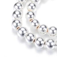 Silverfärgad hematit runda 4 mm, 1 sträng