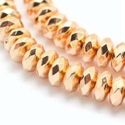 Ljust guldfärgad hematit facetterade rondeller 6x3 mm, 1 sträng