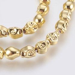 Guldfärgad hematit, döskallar, 10 st