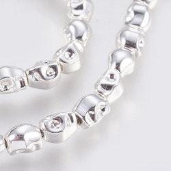 Silverfärgad hematit döskallar, 10 st