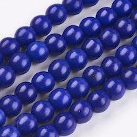 Howlite 6 mm blå, 10 strängar