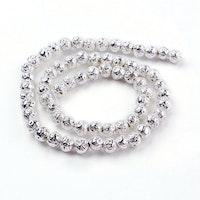 Lavapärlor silver 4 mm, 1 sträng