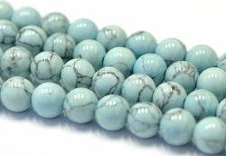 Syntetisk turkos blå 4 mm, 1 sträng