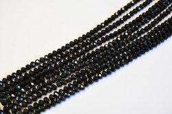 Facetterade abacus 4x3 mm svarta, 1 sträng