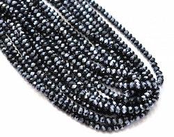Facetterade abacus 8x6 mm svarta glittriga, 1 sträng