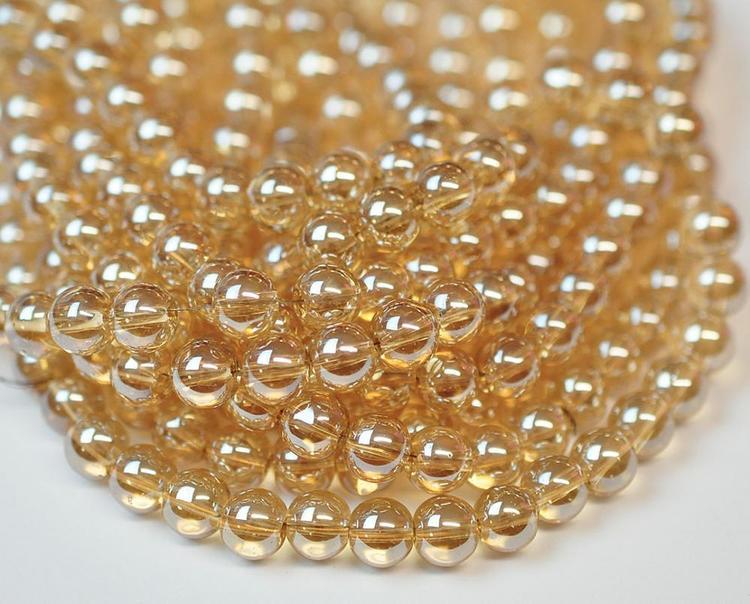 Glaspärlor 6 mm guld, 1 sträng