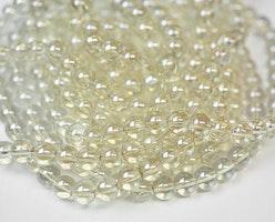 Glaspärlor 6 mm ljust guld, 1 sträng