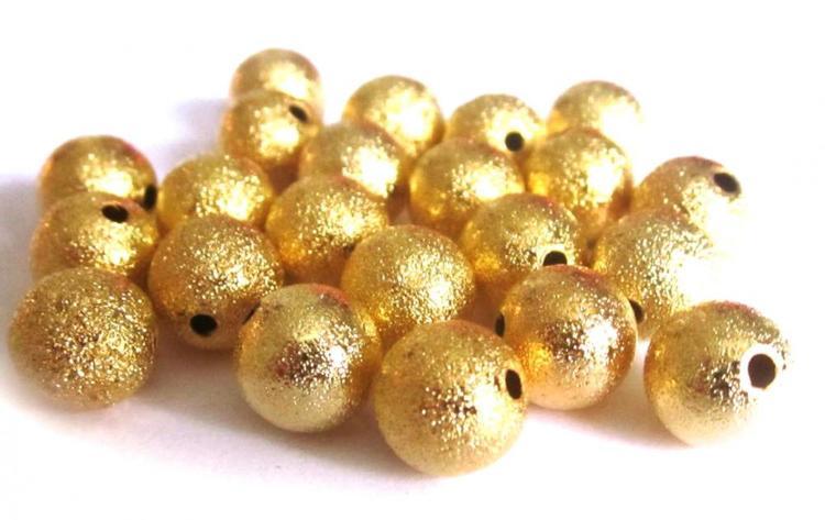 Guldfärgade stardust 6 mm, ca 100 st