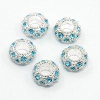 Silverfärgad strassdonut 10 mm turkos, 1 st