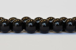 Vaxade glaspärlor svarta 8 mm, 1 sträng
