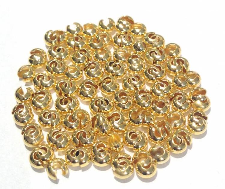 Guldfärgade knutgömmor 5 mm, ca 100 st