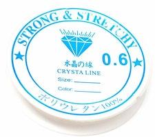 Vit elastisk rund tråd 0.6 mm, 1 rulle