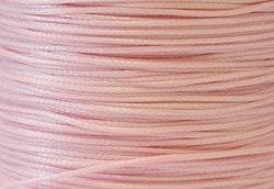 Vaxad bomullstråd 0.5 mm ljusrosa, 1 rulle