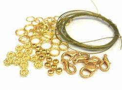 Startpaket, guldfärgad metall