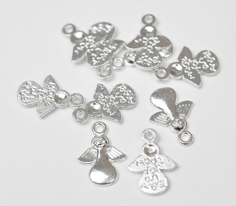 Silverfärgade berlocker Made for an angel, ca 100 st