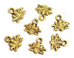 Antikt guldfärgade berlocker små lotusblommor, 10 st
