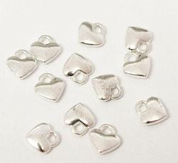 Silverfärgade berlocker små hjärtan, 10 st