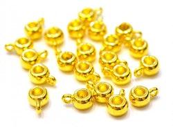 Guldfärgade hangers, ca 100 st