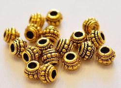 Antikt guldfärgade fint mönstrade tunnor, 10 st