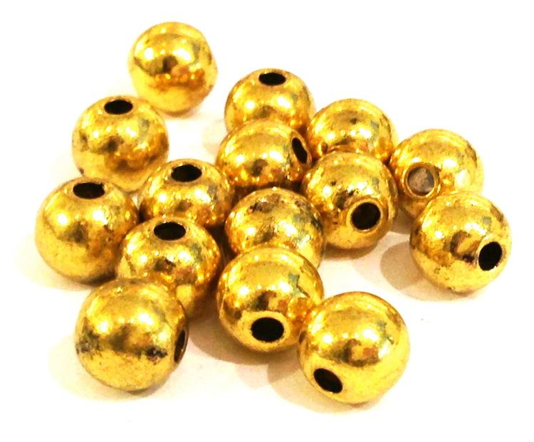 Antikt guldfärgade metallpärlor 3-4 mm, ca 200 st