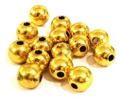 Antikt guldfärgade metallpärlor 6 mm, ca 100 st