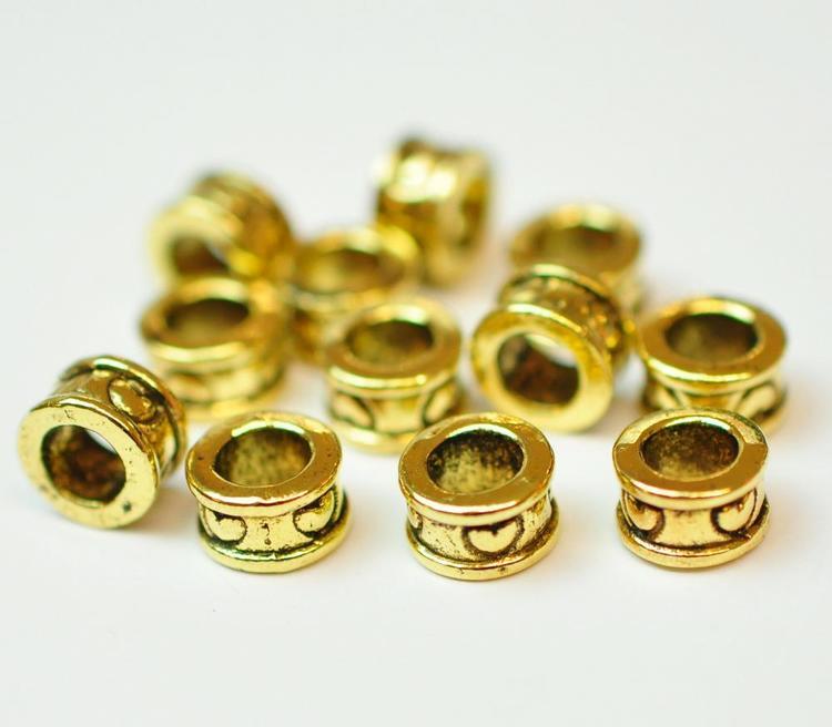 Antikt guldfärgade smala tunnor med hjärtan, ca 100 st