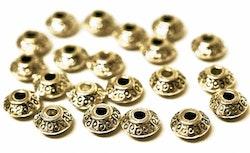 Antikt guldfärgade mellandelar bicone 6 mm, 20 st