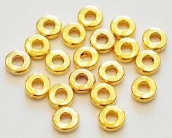 Guldfärgade mellandelar raka och runda 6 mm, ca 100 st