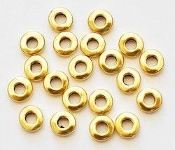 Antikt guldfärgade mellandelar raka och runda 6 mm, ca 100 st