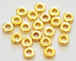 Guldfärgade mellandelar raka och runda 6 mm, ca 1000 st