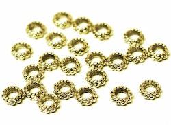 Antikt guldfärgade mellandelar dots, ca 100 st