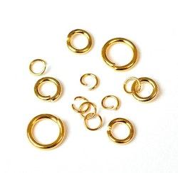 Guldfärgat rostfritt stål bindringar mix, ca 50 st