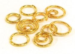 Guldfärgade bindringar mix, ca 200 st