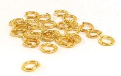 Guldfärgade bindringar 4 mm, ca 50 st