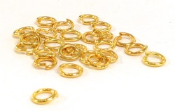 Guldfärgade bindringar 6 mm, ca 50 st
