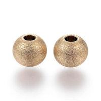 Guldfärgat rostfritt stål stardust pärla 10 mm, 1 st