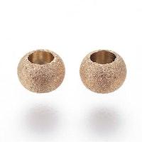 Guldfärgat rostfritt stål stardust pärla 4 mm, 1 st