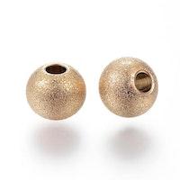 Guldfärgat rostfritt stål stardust pärla 6 mm, 1 st