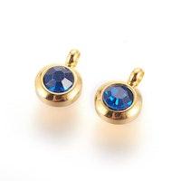 Guldfärgat rostfritt stål berlock med ögla, liten blå, 1 st