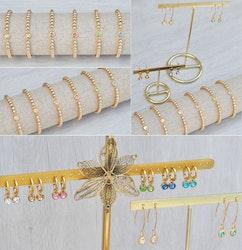 Guldfärgat rostfritt stål berlock med ögla, liten mörkblå, 1 st